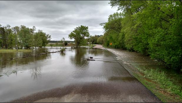 Water streamed over Thompson Road on the north side of the bridge that spans the Buffalo River. Several roads between Mondovi and Eleva were partially closed last week.