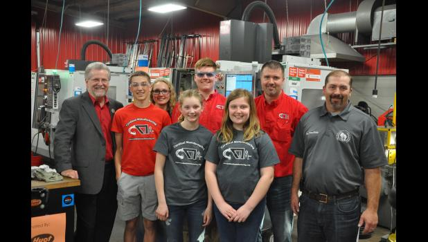 Cardinal Manufacturing students and program advisor Craig Cegielski posed with 93rd Assembly Rep. Warren Petryk of Eleva (left) and 92nd Assembly Rep. Treig Pronschinske of Mondovi (right), who attended the student-run manufacturing operation's annual open house on Monday, April 30.