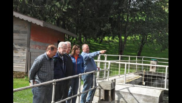 "Local dairy farmer Joe Bragger explained to Secretary Sheila Harsdorf and State Assembly Reps Treig Pronschinske and Warren Petryk how he operates a spring-fed brown trout farm in close proximity to his dry cow shed. ""We have the fish and the cows all together,"" Bragger explained to his visitors. ""You can have all this and still have a good creek."" Secretary Harsdorf joined Reps Pronschinske and Petryk on Thursday, Sept. 20, for a visit to Bragger Family Dairy and a discussion of issues facing the ag sector"