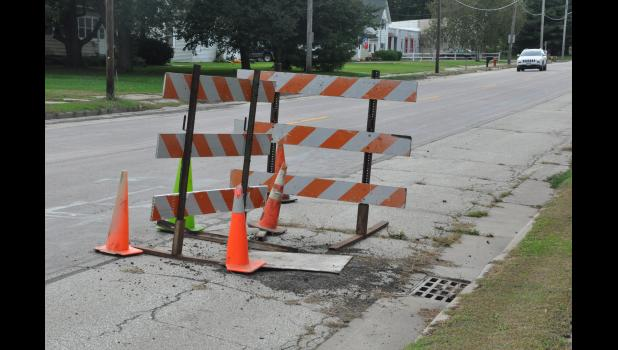 A failing stormwater junction box in the 600th block of West Main Street has been blocked off by barricades for weeks to prevent vehicles from driving over the crumbling structure. City leaders say it's another example of failing infrastructure they're having a difficult time keeping pace with through routine maintenance alone, forcing emergency projects.