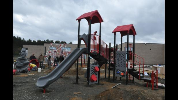 The main play structure was up as the Playground Build Day for the E-S Elementary playground entered the afternoon hours on Friday, Oct. 19.