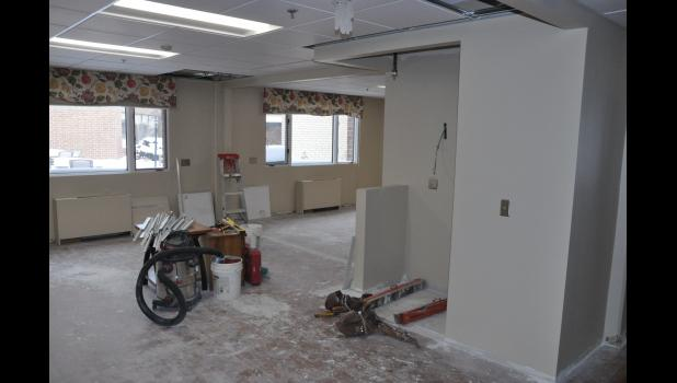Work began in mid-November to create a new, 12-bed assisted living wing within the existing ALC facility. Here, a wall between two former short-term rehab rooms was removed to make way for a common area for the new Hillview Senior Living unit.