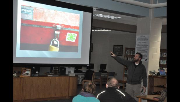 Buffalo County Investigator Mike Osmond gave an example of drugs improperly secured in a home with children. The padlock is not actually keeping the box locked, Osmond pointed out, and the 4-H sticker could help conceal the presence of drugs to an untrained eye. Osmond's presentation at the Mondovi School last week was packed with both stunning and useful information related to drug use and identification.