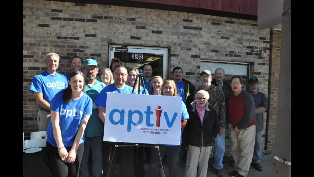 A group of staff, board members and program participants gathered at the Riverfront-Mondovi office, 132 S. Eau Claire St., on Oct. 9 to reveal the organization's new name. Aptiv is part of a fresh brand strategy to convey the non-profit's work to help participants live, learn and work in their communities by focusing on their aptitude to learn new skills and on identifying adaptive options to help them succeed.