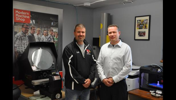 New middle/high school principal Scot Kelly (right) brings experience in the private sector of manufacturing, as a tech ed teacher and as an administrator to Eleva-Strum Central High School. When he decided to go into education several years ago, Kelly served as a student teacher for E-S tech ed teacher Craig Cegielski (left).