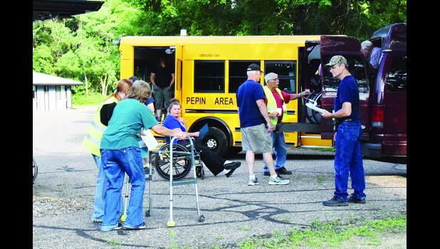"Emergency personnel, and staff members from Pepin Health and Rehab, work together to evacuate ""residents"" from the facility during a training exercise held last Wednesday evening. Laura Berndt photo"