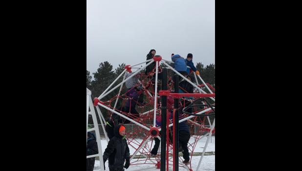 E-S fourth and fifth grade students tried out the climbing web at the new E-S Elementary playground.