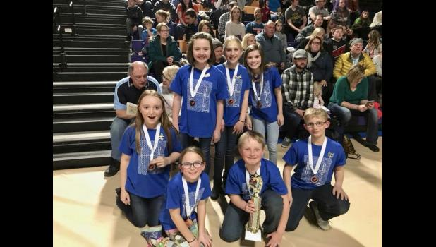 "Members of the ""Tune Transformers,"" Mondovi Elementary's fourth and fifth grade Destination Imagination team, posed with their medals and team trophy after taking third place at the state DI competition in Stevens Point on March 24 to punch their ticket to Globals in Knoxville, Tenn., next week. Team members are (pictured, front, left to right) Adella Anderson, Ethan Odegard, Hunter Wik; back, Bethany Risen, Molly Avery, Miriam Sandberg, Julia Heike."