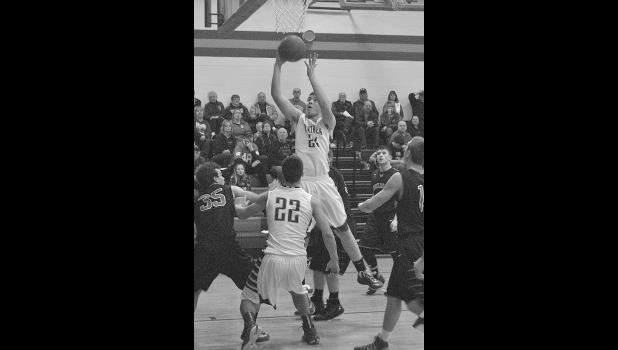 Isaac Annis goes for a layup against Baldwin-Woodville.