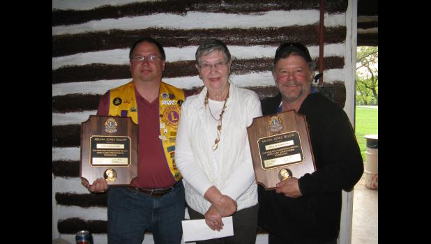 Mondovi Lions Club members Rob Ganschow (left) and Paul Woebbeking (right) were recently honored with the Melvin Jones Fellowship award for their contributions locally and to the Lions Clubs International Foundation. Presenting the special recognition to the two Mondovi men at a recent Lions Club meeting was Anita LeCleir (center), a past president of the organization.