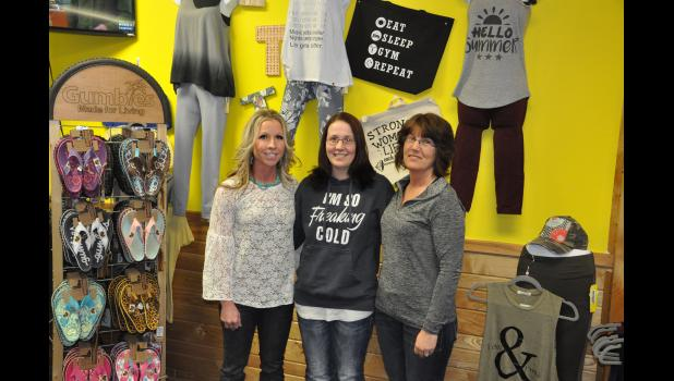 A trio of co-owners in (left to right) Tracy Olson, Tracey Schwartz and Tina Bursaw recently founded Triple T Tanning, Active Wear & More. The new shop offers a wide selection of active/workout wear, regular tanning and red light therapy beds, and more.