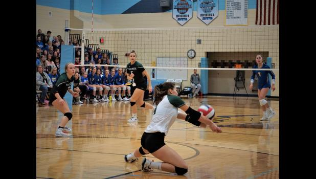 Abigail Bell slides to saves the  ball from hitting the floor during the sectional finals match. Photo by Fall Creek Sports History