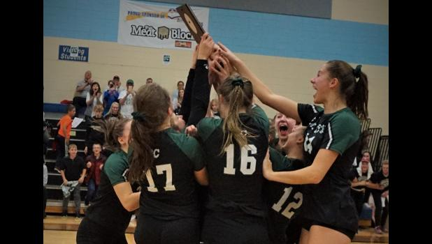 Fall Creek players celebrate winning the sectional title, the school's first in volleyball. Photo by Fall Creek Sports History