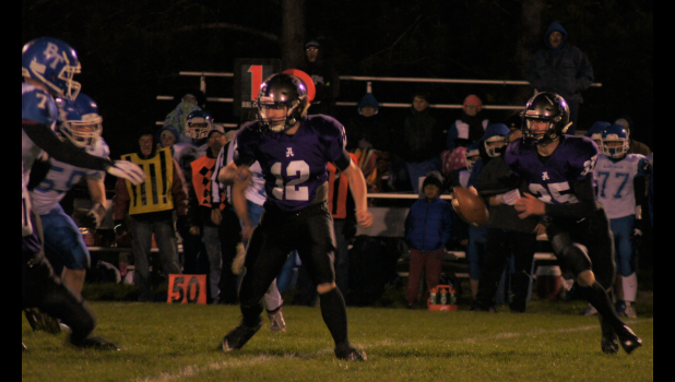 Augusta quarterback Traven Fabian with the ball.