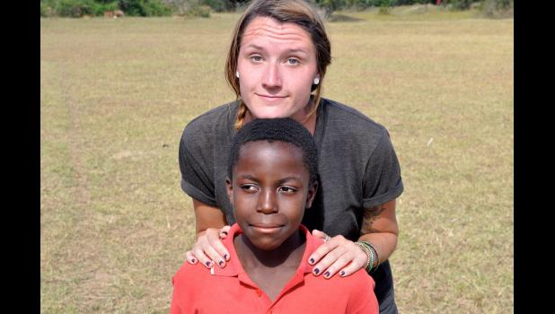 Volunteer Alexa Moore shares a moment with her host brother Joseph during her time spent with the Peace Corps in Zambia Africa. Moore is currently in the country, and will continue to volunteer for the next 10 months.