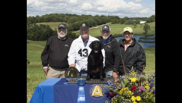 """Randy Spangler of Mondovi and his dog """"Mully"""" recently claimed their first National Amateur Championship title at the 2017 NARC event, held in rural Mondovi. Pictured with Mully and his championship hardware are, left to right, Dean Reinke from Purina, handler/owner Randy Spangler, trainer Wayne Curtis of Fox Hollow Retrievers, LLC, and Karl Gunzer from Purina."""