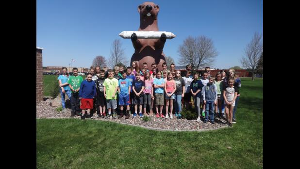 The entire fifth grade student body stands outside the Augusta School District. Together, they worked to piece together the landmarks, history and story of the city into a Google Expedition for all the world to see.  hugs front: Augusta students walk around the city picking up trash on the road as part of a way to give back to the community during their Hugs for Humanity event on Friday, May 4. (Contributed photo)