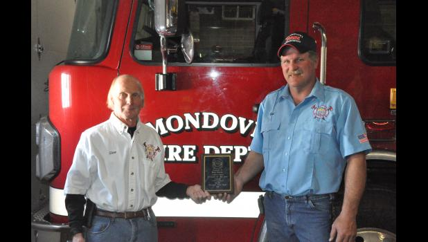 Mondovi Fire Chief Steve Anderson (left) recently presented the fire department's 2018 Firefighter of the Year award to Bob Myren, a 10-year member of the MFD who handles all routine vehicle maintenance work for the department's fleet.