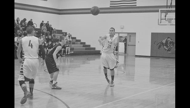 Jake Dunbar dishes out a pass against Baldwin-Woodville in Durand January 20. The Panthers fell 55-50, but won 48-40 over Somerset January 23.