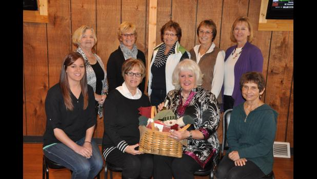 Members of the Women's Holiday Luncheon Committee include, front, left to right, Leslie Matchey, Katie Mahlum, Charlie Warner, Jeanne Everson; back, Rosemary Smith, Jane Crawford, Karen Kees, Jeanette Brenner, Janice Swenson. Not pictured—Kim Bauer.