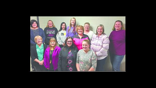 PEM paraprofessionals in attendance smile moments after being recognized by the School Board at the board's Monday, Jan. 8 meeting. National Paraprofessional Week is Jan. 22-26. Pictured in the front row, left to right, is Julie Herrmann, Jennifer Torres, Kara Zabel and April Wolf. Pictured in the back row, left to right, is Mindy Yoch, Julie Liebenow, Mandy Breza, Amy Lyons, Donna Schneider, Cheryl Theel, Deb Sexton and Sandy Webster. Photo by Michael Flicek