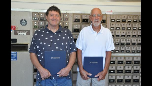 Mondovi rural postal carriers Randy Duncanson (left) and Wayne Diller were officially recognized for their retirements earlier this month. Diller logged 36 years of service, retiring on Jan. 3, and Duncanson, who retired April 30, worked full-time for 17 years plus another 17 years as a sub.