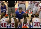 The Eagles discuss the game plan during a time out earlier this season. Heidi Stewart photo