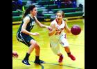 Adrianna Baab drives hard for the basket in action from the first half of the Girls' game Thursday night in La Crescent.