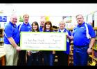 Above are Pepin Area Schools District Administrator Bruce Quinton, and Pepin Area School District's Board of Education members Tim Stajkowski, Debra Larson, Gordon Riesgraf, Betty Glander, and Ardyce Johnson, and maintenance worker Russ Roundy, with a check from Focus on Energy and Xcel Energy, to replace all the District's interior and exterior lighting fixtures with LED lighting. Laura Berndt photo