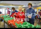 Members of the Court St. Charles Catholic Daughters spent their Saturday morning filling Christmas baskets with goodies, which they later delivered to local residents. Above are Fran Goodrich and Deb Rowekamp.