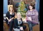 Amy Brown, Heidi Peterson and Becki Burt welcome guests to their Holiday Open House at Amy's Salon 211 in Eyota on Friday evening.
