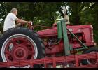 """Hey Charlie Uecker, this is how you balance a tractor on the balance beam game!""  Both Dale Kautz (pictured) and Jeremy Strain (not pictured) took Charlie's tractor up onto the balance beam and showed him how to get the job done.  Evidently Charlie could not get this tractor balanced, but the other two guys did!"