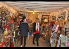 Customers browse one of the three aisles at Brenn's Barn filled to the rafters with home decor, antiques and Christmas items.