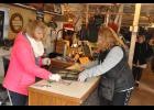 Mary Ann Olson, owner of Brenn's Barn Boutique, assists a customer with a purchase during the barn's final opening of 2018 in conjunction with the Christmas Walk on Nov. 3.