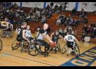 Wheelchair basketball players scrambled for a rebound. In addition to Collin Evans' teammates on the Junior Rolling Timberwolves squad, members of other teams at the Courage Kenny Rehabilitation Institute, based in the Twin Cities area, played in the Mondovi demo.