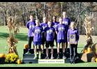 Above, from left to right in the front row, are team members Brett Tomlinson, Wesley Brantner, Isaac Wegner, and Durand head cross country coach Ingrid Husmoen. In the second row are Mason Richardson, Ely Bauer, Amanuel Bauer, and Riley Radle. Laura Berndt photo