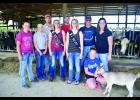 The Holst family is hosting this years Wabasha County Family Night on the Farm, Pictured L to R are:  Ashley, Brittany Nelson, Jacob, Abigail, Isaac, Natalie, Jary, Celene, and Beth with her goat.