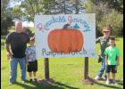 Tom and Ginny Ties with their grandsons, Nick and Ray Pitzen by the Remarkable Journey Pumpkin Patch sign at the Tews Corn Maze on Sunday afternoon.  The family was out enjoying the sunshine, the pig races, the duck races, the hayride and all the other events found on the Tews Farm!  A great place for fun and family outings!  The Remarkable Journey Pumpkin Patch takes donations for the pumpkins freshly picked from the field.  The donations go to special people that  may need a little extra kindness along t