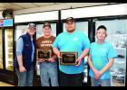 J.M. Watkins LLC, of Plum City, earned multiple awards during the Wisconsin Meat Product Competition at the 78th annual convention of the Wisconsin Association of Meat Processors. Pictured from left to right are Erin and Brandon Clare, Charles Link, and Gloria Watkins. Laura Berndt photo