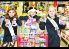 Members of the Durand royalty used their winnings from the Dazzle Day Christmas Tree Decorating Contest to help the Pepin County Humane Society. Above, from left to right, are Marley Brommer, Brock DeGroot, and Madelyn Fregine. Submitted photo