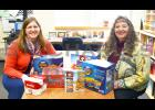 Pictured above are Gretchen Hoffman, of the St. Charles Elementary School Weekend Food Backpack Program, and Pastor Heather Klason, who represents the Ministerial Association, with just a few of the many items the Ministerial Association recently collected for and donated to the Backpack Program. Photo by St. Charles Press Editor Laura Berndt.