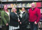 The new school board members are sworn in to their new roles.  Sarah Sommer, Jenny Koverman, Brein Maki, and Greg Bronk are welcomed to the Lewiston Altura School Board on Monday night, January 9, 2017.    Photo by Carol Boynton