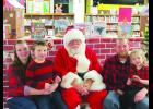 Virginia, Kalton, Justin and Olivia Kerns with Santa.  Photos by Carol Boynton