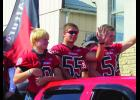 Justin Mueller, Cody Rain and Thomas Hennessy wave to the parade goers on Friday afternoon.  A great time leading up to the Homecoming game and dance for the Lewiston Altura Cardinals.  Photo by Carol Boynton