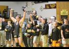 The PEM wrestlers celebrate their win over conference rival Caledonia last Tuesday night.