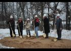 Breaking new ground Thursday, Nov. 13, Marty Metten, Jane Justesen, Tamy Moss, City Public Works Director Chet Krueger, Augusta Area Home Board President Alan Ross and Home Administrator Jahn Bradley smile as they shovel dirt from a piece of the land soon to be the new Augusta Area Home facility.