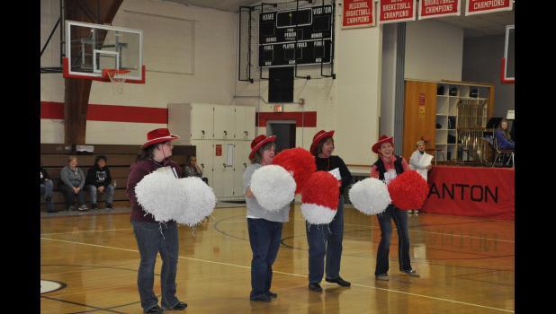 Several teachers served as energetic cheerleaders, performing practiced cheers during the pep rally.