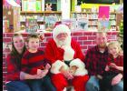 Virginia, Kalton, Justin and Olivia Kerns with Santa.  Photos by Carol Boynton